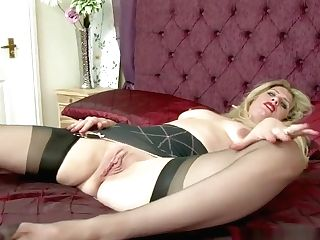 Blonde Cougar Hoe Taunting And Playing With Muff In The Bedroom In...